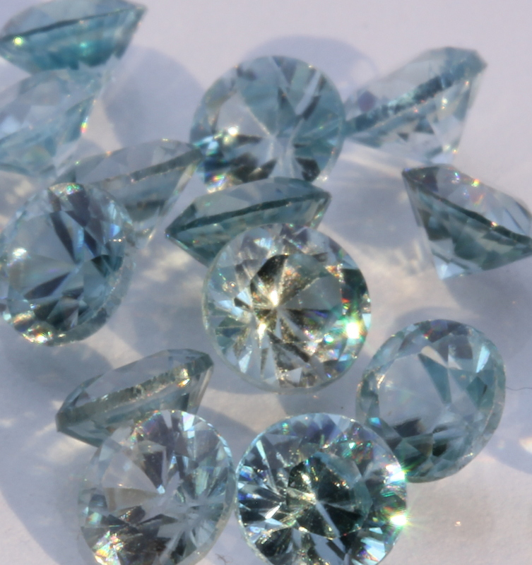One Blue Zircon Well Faceted 4 mm Round Accent Gemstone Averages 0.36 carat.