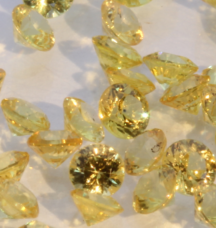 One Yellow Sapphire Well Faceted 2.5 mm Round Accent Gem Averages 0.08 carat.