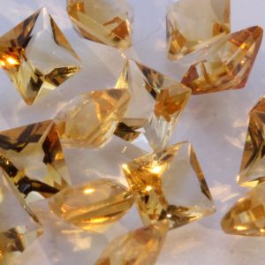 One Yellow Orange Citrine Well Faceted Oval Accent Gemstone Averages 0.30 carat.