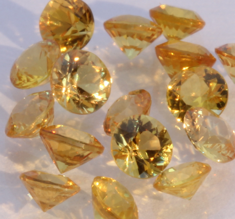 One Yellow Sapphire Well Faceted 4 mm Round Accent Gemstone Averages 0.11 carat.