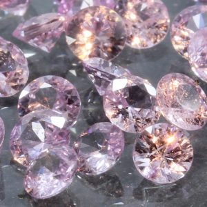 One Light Pink Sapphire Accent Faceted Round 3 mm Gemstone Averages .13 carat