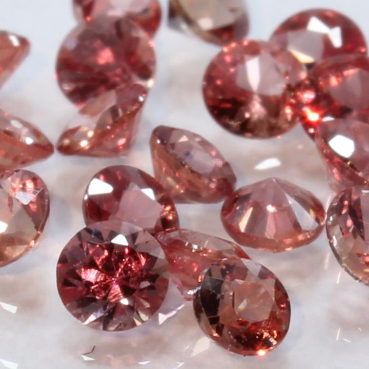One Red Orange Sapphire Faceted 2.5 mm Round Accent Gemstone Averages .08 carat