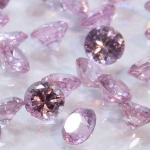 One Pink Sapphire Well Faceted 2.5 mm Round Accent Gemstone Averages .08 carat