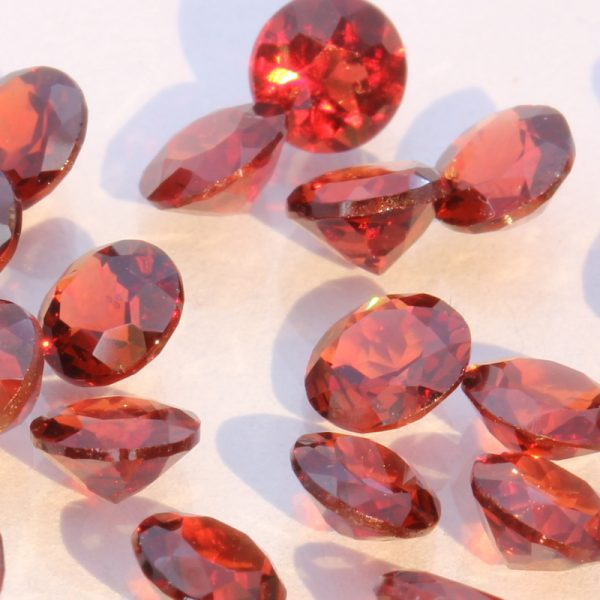 One Red Orange Mozambique Garnet Faceted Round 4 mm Gemstone Average .30 carat