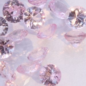One Light Pink Sapphire Accent Faceted Round 3 mm Gemstone Averages .12 carat