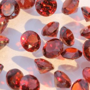 One Deep Red Mozambique Garnet Accent Faceted Round 3 mm Average .15 carat