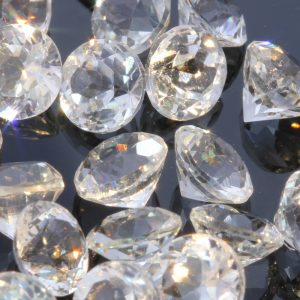 One White Topaz Natural Faceted 5 mm Round Accent Gemstone Averages .69 carat