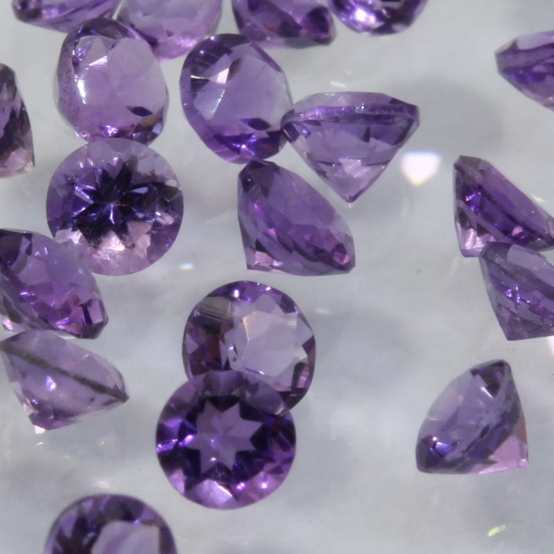 One Amethyst Accent Gemstone 2.5 mm Faceted Round VS Clarity Average .06 carat
