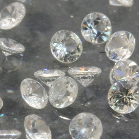 One White Sapphire Natural Faceted 2 mm Round Accent Gem Averages .04 carat