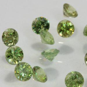 One Yellow Green Demantoid Garnet Diamond Cut Round 3 mm Average .12 carat