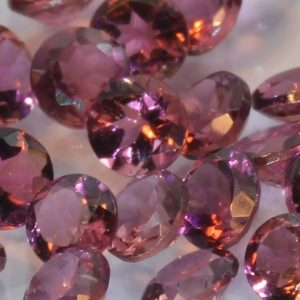 One Pink Tourmaline Accent Gem 2.5 mm Diamond Cut Round Average .06 carat each