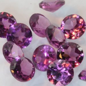 One Purple Rhodolite Garnet Accents 3.5 mm Faceted Round Average .20 carat each