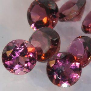One Pink Tourmaline Accent Gem 3 mm Diamond Cut Round Average .09 carat each