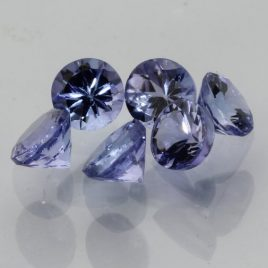 One Sparkling Blue Purple Tanzanite Accent 2.5mm Faceted Round Average .06 carat