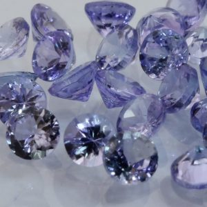 One Blue Purple Tanzanite Accent 3mm Faceted Diamond Cut Round Average .17 carat