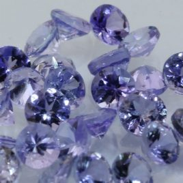 One Blue Purple Tanzanite Accent 3mm Faceted Diamond Cut Round Average .17 carat