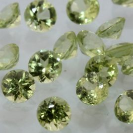 One Yellow Green Peridot Accent VS Gem 2.5 mm Faceted Round Average .07 carat