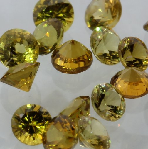 One Yellow Mali Garnet Accent Gem 2.5 mm Faceted Round Average .07 carat each