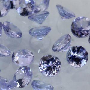 One Light Blue Purple Tanzanite Accent 2.5 mm Faceted Round Average .07 carat