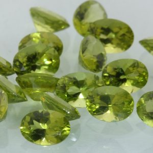 Peridot One Yellow Green 7x5 mm Faceted Oval Cut VS Average Gem .80 carat each