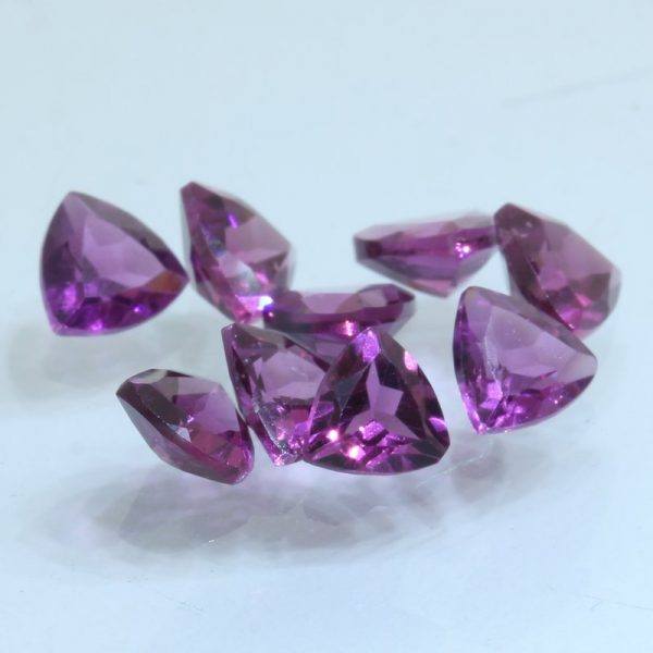 One Rhodolite Garnet 4 mm Reuleaux Triangle Trillion Cuts Average .28 carat each