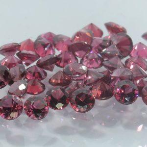 One Purple Red Sapphire Accent Gem 3 mm Diamond Cut Round Average .12 carat each