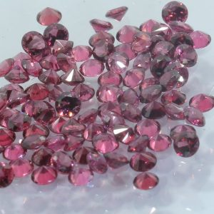 One Pinkish Purple Spinel Mogok Burma Faceted Rounds 2.5 mm Averages .06 carat