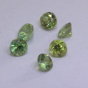 One Yellow Green Demantoid Garnet Round 2.8mm Diamond Cut Gems Average .10 carat