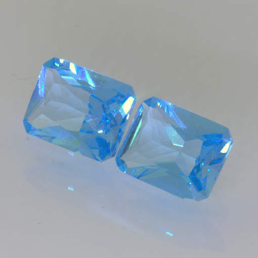 Swiss Blue Topaz Matching Pair Faceted 9 x 7 mm Emerald Cuts 5.42 Total Carat